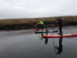 Andy, Rhona, and Deano taking it easy. Photo courtesy of Wilderness SUP