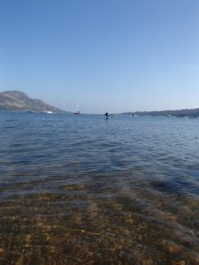 Deano paddling back from Holy Isle
