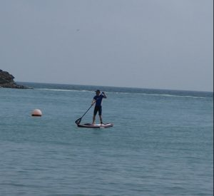 Deano SUPing at Lulworth Cove