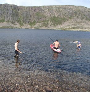 Safety SUPing for a very chilly swim across the loch