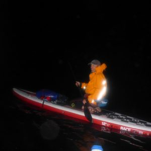 Deano getting ready to stand up and paddle off into the darkness - Photo courtesy of Ian, SUP Ecosse